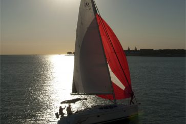 Hunter 39 Under Sail in Chicago during the sunset.
