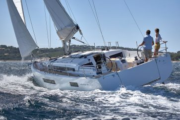 Sun Odyssey 440 Under sail by couple, slightly heeling.