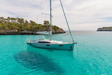 Beneteau 41.1 anchored in a tropical cove.