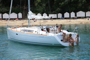Beneteau 37 anchored with family enjoying the water.