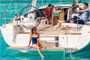 ownership couple on boat swim platform