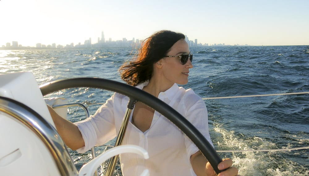 Chicago sailor at helm
